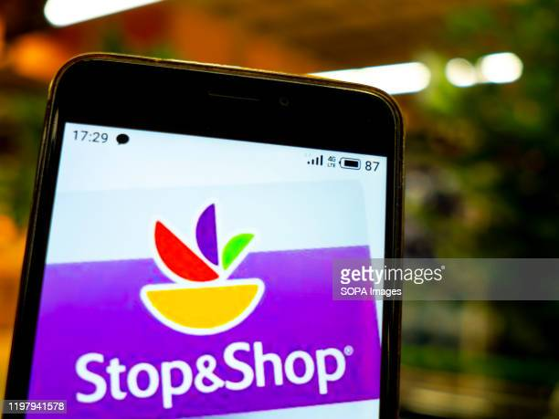 In this photo illustration the Stop Shop logo is seen displayed on a smartphone
