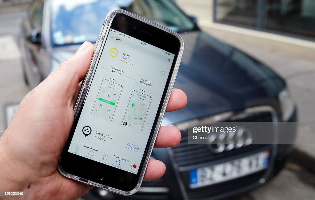 In this photo illustration, the Taxify company application is displayed on the screen of an Apple iPhone 6 on October 06, 2017 in Paris France. The new car-hailing service Taxify is preparing to take on Uber in Paris, after being boosted by investment from China's Didi Chuxing. Taxify, the Estonian application of connecting customers and private drivers hopes to become a key player in the sector in France. The company plans to charge similar amounts to Uber but will allow drivers to keep a greater share of fares.