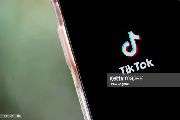 In this photo illustration, the TikTok app is displayed on an Apple iPhone on August 7, 2020 in Washington, DC. On Thursday evening, President Donald...