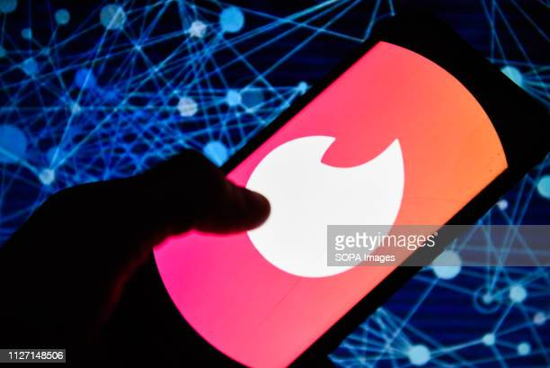 In this photo illustration the Tinder logo is seen displayed on an Android mobile phone