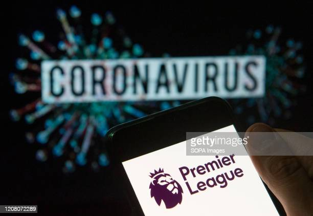 In this photo illustration the top level of the English football league Premier League logo seen displayed on a smartphone with a computer model of...