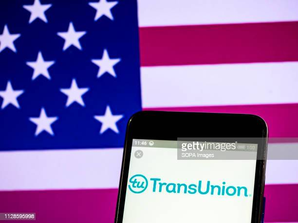 In this photo illustration the TransUnion Company logo seen displayed on a smartphone