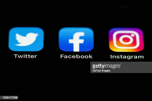 In this photo illustration, The Twitter, Facebook and Instagram logos on the screen of an iPhone on March 09, 2021 in Kirchheim unter Teck, Germany.