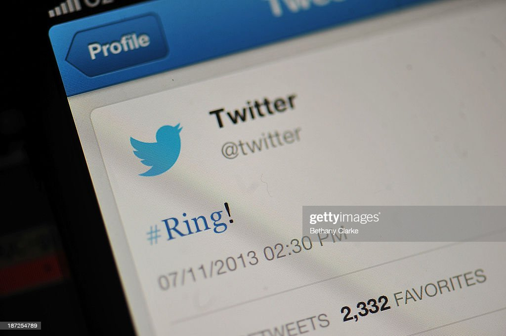 In this photo illustration, the Twitter logo and hashtag '#Ring!' is displayed on a mobile device as the company announced its initial public offering and debut on the New York Stock Exchange on November 7, 2013 in London, England. Twitter went public on the NYSE opening at USD 26 per share, valuing the company's worth at an estimated USD 18 billion.