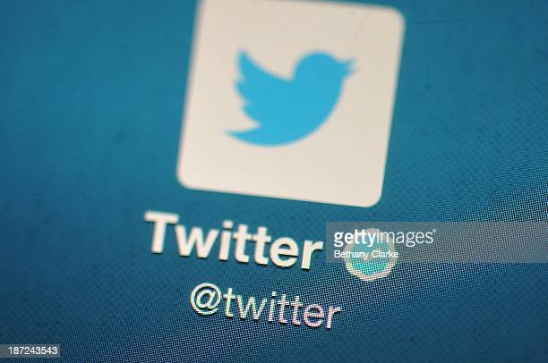 In this photo illustration, The Twitter logo is displayed on a mobile device as the company announced it's initial public offering and debut on the...