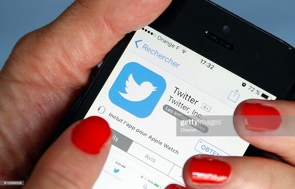In this photo illustration, The Twitter logo is displayed on the screen of an Apple Inc. iPhone 5 in this arranged photograph on September 25, 2016 in Paris, France. According to information from the American television channel CNBC, the Twitter social network could be bought by Google (Alphabet) and Salesforce.com group before the end of the year.