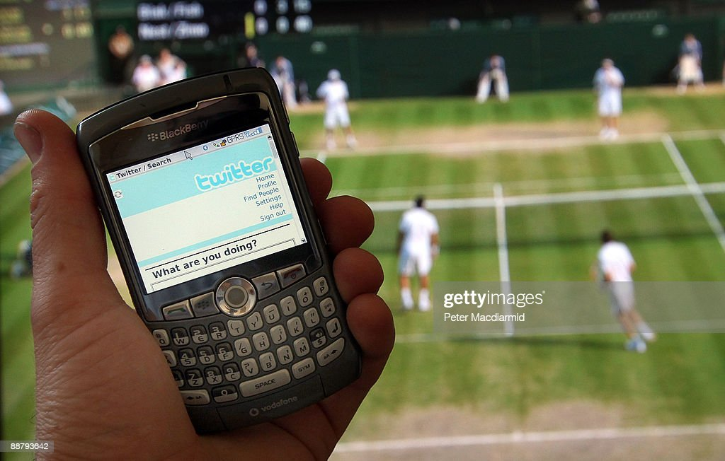 In this photo illustration the Twitter website is displayed on a mobile phone in front of a television showing the tennis at Wimbledon on July 2, 2009 in London. The social network site, started in 2006 in California as a sideline project, has grown into a global brand becoming one of the fastest growing phenomenas of the Internet.