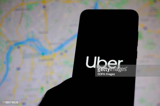 In this photo illustration the Uber logo is seen displayed on a smartphone.