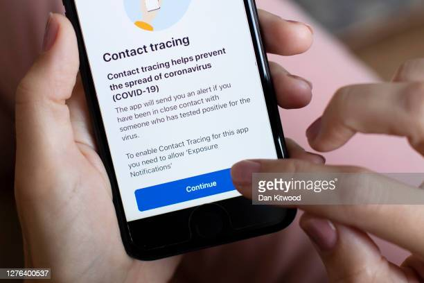 In this photo illustration, the UK governments new test and trace application is displayed on a handheld device, on September 24, 2020 in London,...
