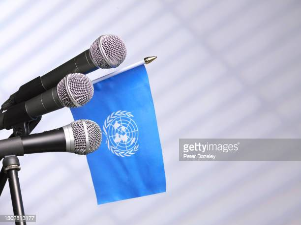 In this photo illustration, the UN flag is seen with microphones on February 16,2021 in London, England.