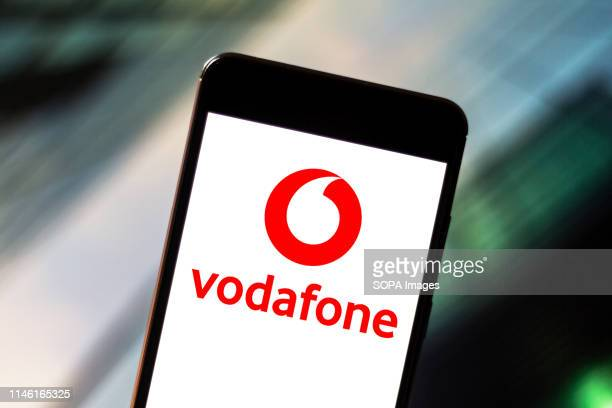 In this photo illustration the Vodafone logo is seen displayed on a smartphone.