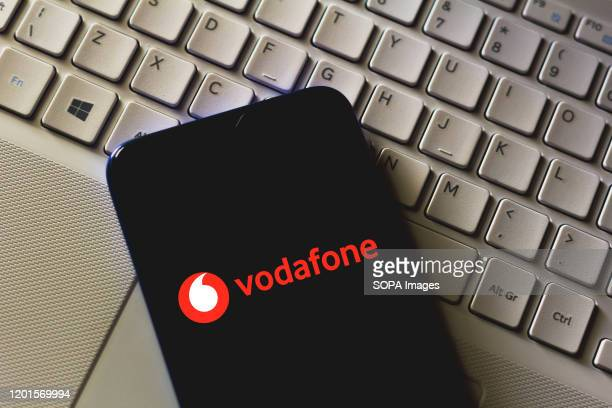 In this photo illustration the Vodafone logo seen displayed on a smartphone.