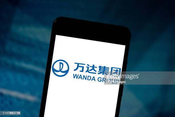 In this photo illustration the Wanda Group or Dalian Wanda logo is seen displayed on a smartphone.