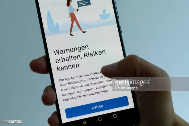 In this photo Illustration The warning received risks kenen page of the Corona Warn app is seen on an Android platform on June 16 2020 in Dortmund...