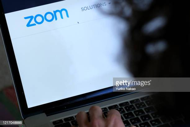 """In this photo illustration, the website of Zoom Video Communications Inc is seen on April 4, 2020 in Katwijk, Netherlands. """"n"""