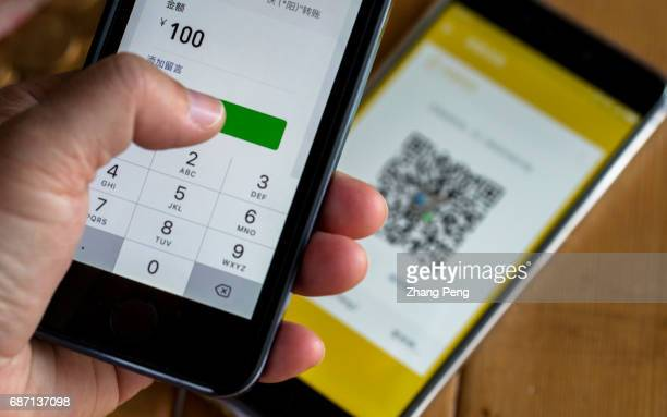 In this photo illustration the WeChat payment on mobile phone Latest data shows that in the first quarter of 2017 WeChat payment accounted for 3951%...