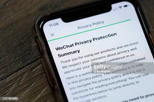 In this photo illustration, the WeChat privacy policy is displayed on an Apple iPhone on August 7, 2020 in Washington, DC. On Thursday evening,...