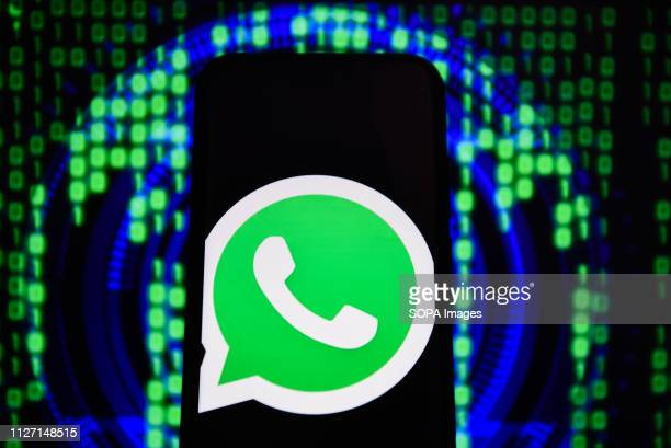 In this photo illustration the WhatsApp logo is seen displayed on an Android mobile phone