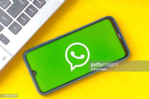 In this photo illustration the WhatsApp logo seen displayed on a smartphone.
