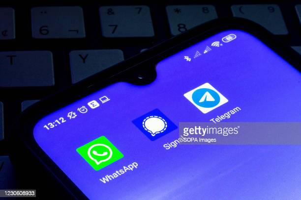 In this photo illustration the Whatsapp, Signal and Telegram app icons seen displayed on a smartphone screen one.
