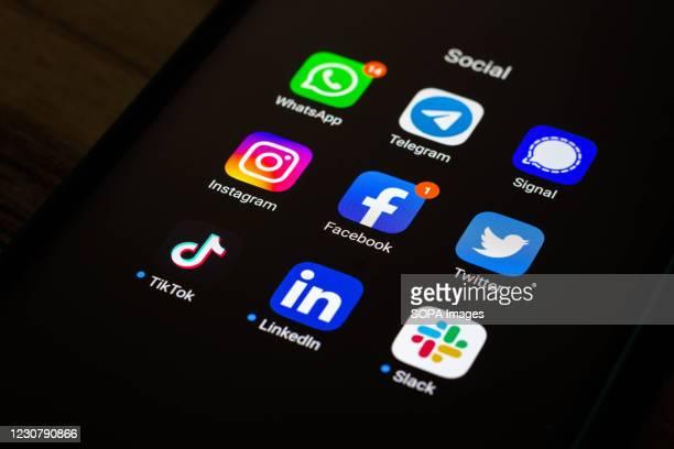 In this photo illustration the Whatsapp, Telegram, Signal, Instagram, Facebook, Twitter, Tik Tok, LinkedIn and Slack app and logos seen displayed on...