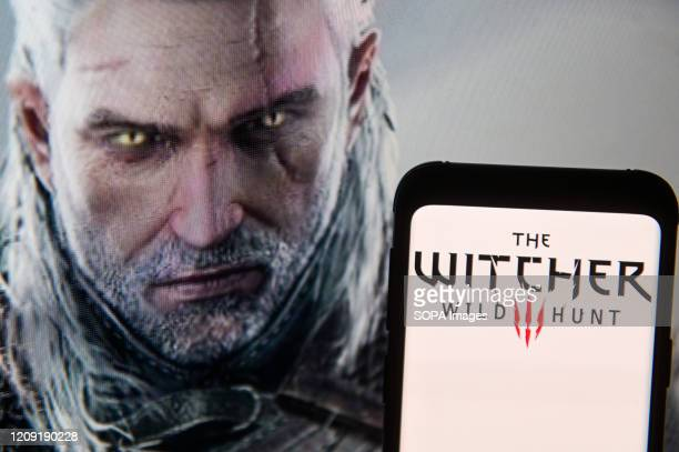 In this photo illustration The Witcher Wild Hunt logo seen displayed on a smartphone
