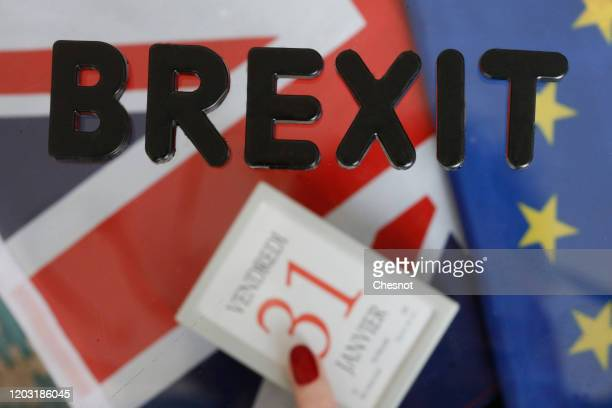 In this photo illustration, the word Brexit is on display on a calendar on January 31 with British and European flags on January 31, 2020 in Paris,...