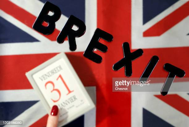 In this photo illustration, the word Brexit is on display on a calendar on date January 31 with a British flag on January 31, 2020 in Paris, France....