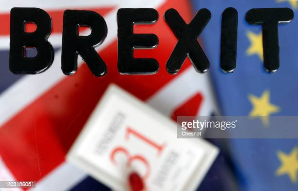 In this photo illustration, the word Brexit is on display on a calendar on date January 31 with British and European flags on January 31, 2020 in...