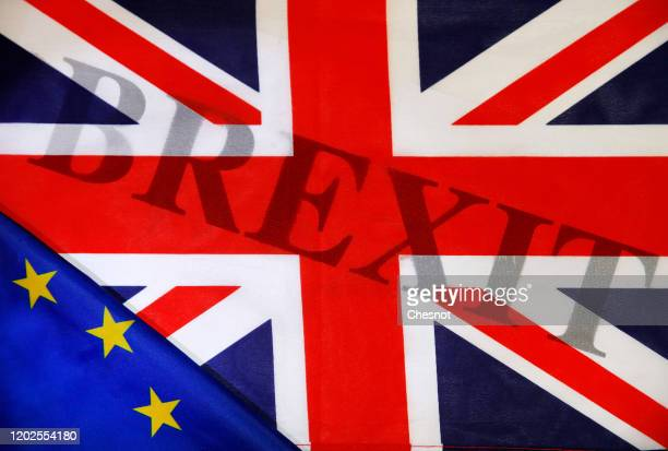 "In this photo illustration, the word Brexit is seen through a British flag and a European flag on January 28, 2020 in Paris, France. ""Brexit"" is an..."