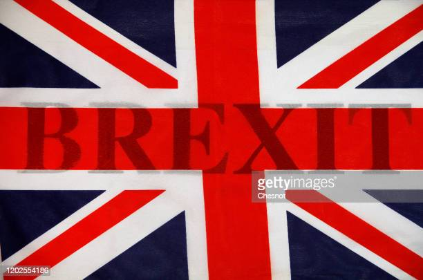 "In this photo illustration, the word Brexit is seen through a British flag on January 28, 2020 in Paris, France. ""Brexit"" is an abbreviation of..."