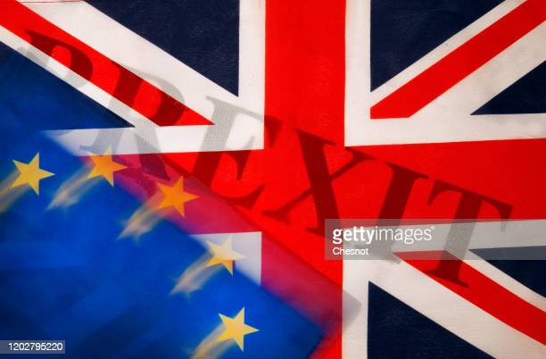 "In this photo illustration, the word Brexit is seen through a British flag next to an European flag on January 29, 2020 in Paris, France. ""Brexit"" is..."