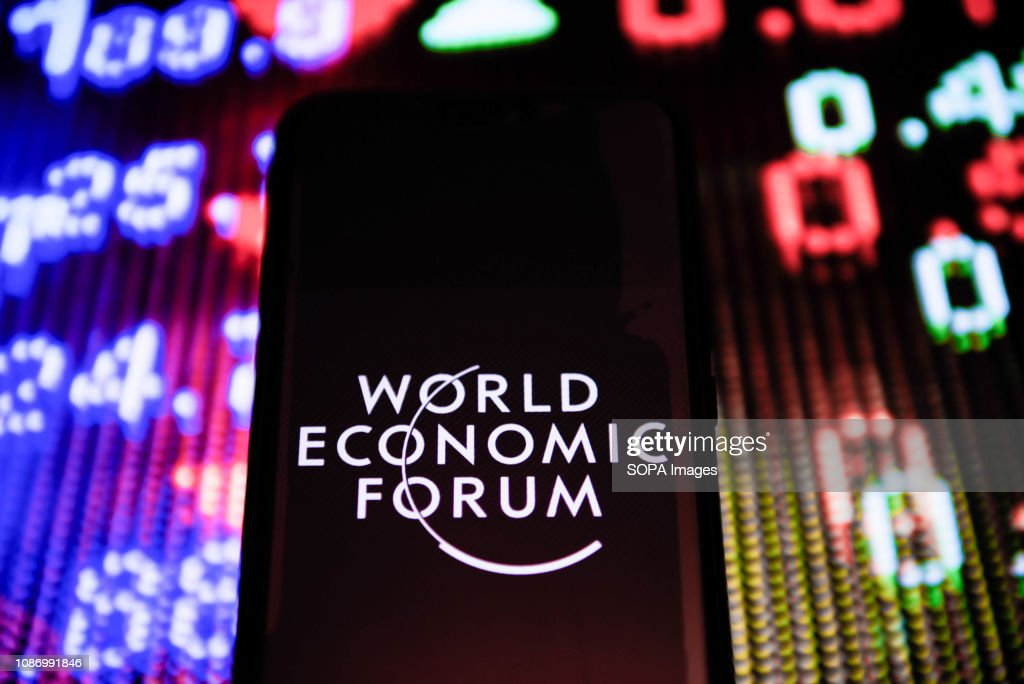 World Economic Forum logo is seen on an android mobile phone : News Photo