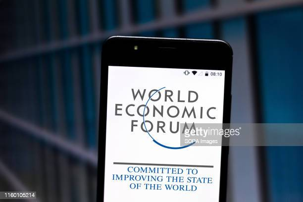 In this photo illustration the World Economic Forum logo is seen displayed on a smartphone