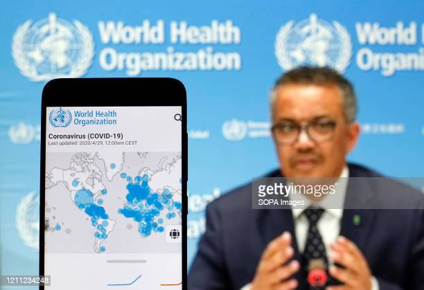 In this photo illustration the World Health Organization Director General Tedros Adhanom Ghebreyesus is seen on a screen of pc and a WHO coronavirus...