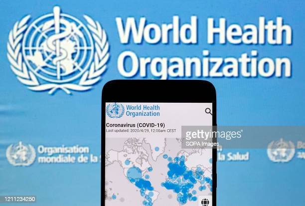 In this photo illustration the World Health Organization map with the COVID-19 coronavirus confirmed cases is displayed on a mobile phone. The number...