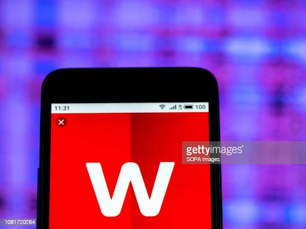 In this photo illustration the Worldpay Group logo seen displayed on a smartphone