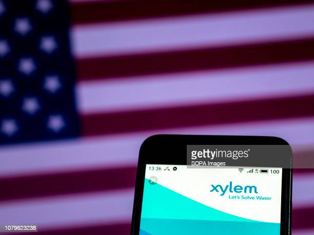 In this photo illustration the Xylem Inc Commercial company logo seen displayed on a smartphone
