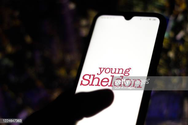 In this photo illustration the Young Sheldon logo seen displayed on a smartphone
