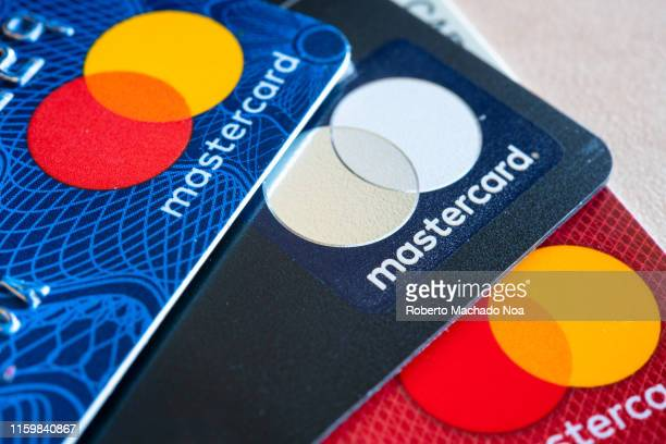In this photo illustration there are three Mastercard Credit Cards. The branding and marketing logo of a financial company. Business related...