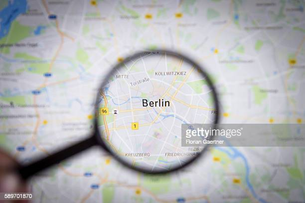 In this photo illustration to the topic 'Berlin' the city is seen on a map through a lens on August 08 2016 in Melaune Germany