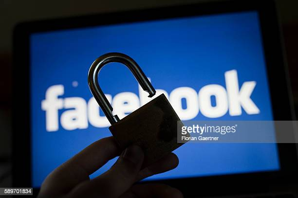 In this photo illustration to the topic 'data security' an open padlock i captured in front of the logo of facebook on August 08 2016 in Melaune...