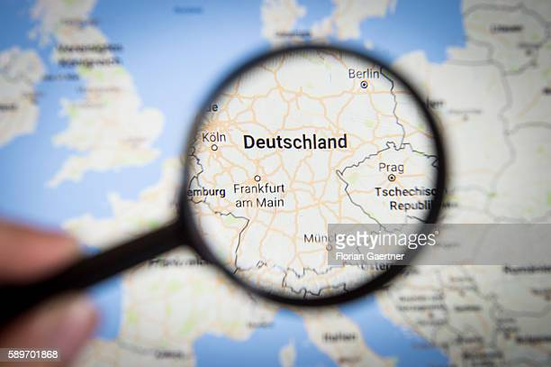 In this photo illustration to the topic 'Germany' the country is seen on a map through a lens on August 08 2016 in Melaune Germany