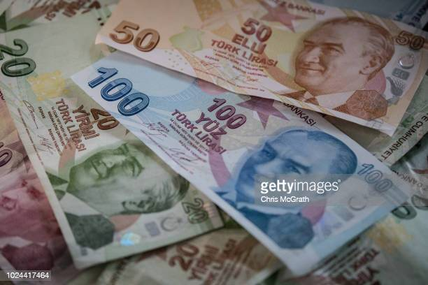 In this photo illustration, Turkish Lira currency is displayed on August 27, 2018 in Istanbul, Turkey. The Turkish lira slid to 6.22 against the...