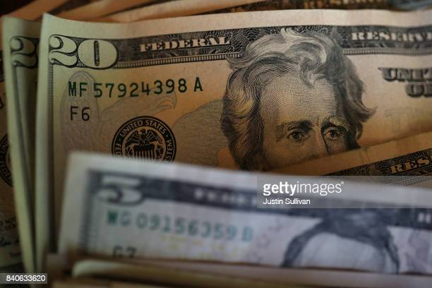 In this Photo Illustration Twenty and five dollar bills are displayed on August 29 2017 in San Anselmo California The dollar fell to a two and a half...