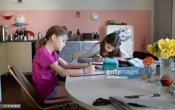 In this photo illustration two girls are doing homework on May 19 2020 in Bonn Germany