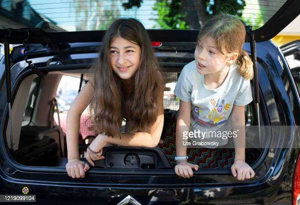 In this photo illustration two girls look out the trunk of a car on May 28, 2020 in Bonn, Germany.