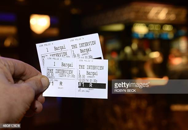 In this photo illustration two tickets for the movie 'The Interview' are seen in front of the Los Feliz 3 Cinema in Los Angeles California on...