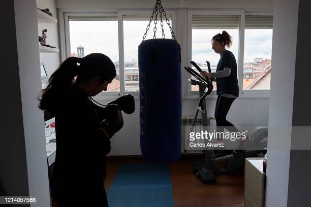 In this photo illustration, two women do gymnastics at home on March 22, 2020 in Madrid, Spain. As part of the measures against the virus expansion...