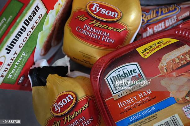 In this photo illustration Tyson Food and Hillshire Brands food products are seen on May 29 2014 in Miami Florida Tyson Foods made a $ 68 billion...